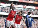 Arsenal striker Danny Welbeck celebrates with Alexis Sanchez after scoring during his side's Premier League clash with Manchester United at the Emirates Stadium on May 7, 2017