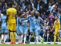 Vincent Kompany celebrates scoring with teammates during the Premier League game between Manchester City and Crystal Palace on May 6, 2017