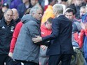 Arsene Wenger and Joe Mourinho shake hands during the Premier League game between Arsenal and Manchester United on May 7, 2017