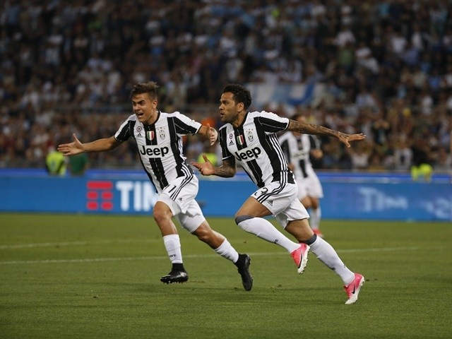 Juventus's Davi Alves celebrates scoring during the Coppa Italia final against Lazio on May 17, 2017
