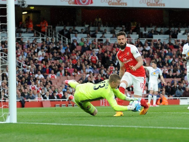 Jordan Pickford saves a shot from Olivier Giroud during the Premier League game between Arsenal and Sunderland on May 16, 2017
