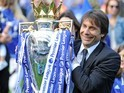 Antonio Conte poses with the trophy during the Premier League game between Chelsea and Sunderland on May 21, 2017