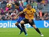 Sandro Ramirez and Sergio Busquets during the La Liga match between Malaga and Barcelona on November 19, 2016