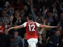 Olivier Giroud celebrates scoring during the Premier League game between Arsenal and Leicester City on August 11, 2017