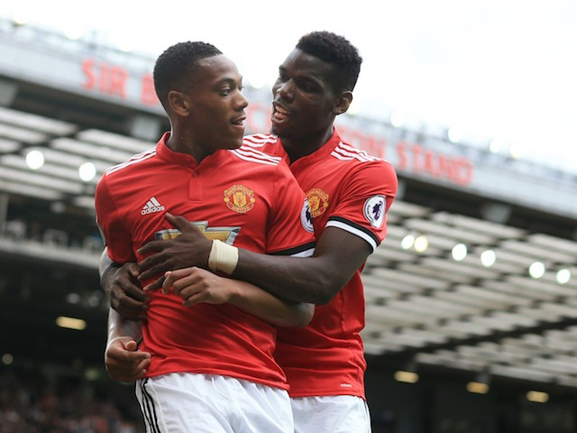 Anthony Martial celebrates with Paul Pogba during the Premier League game between Manchester United and West Ham United on August 13, 2017