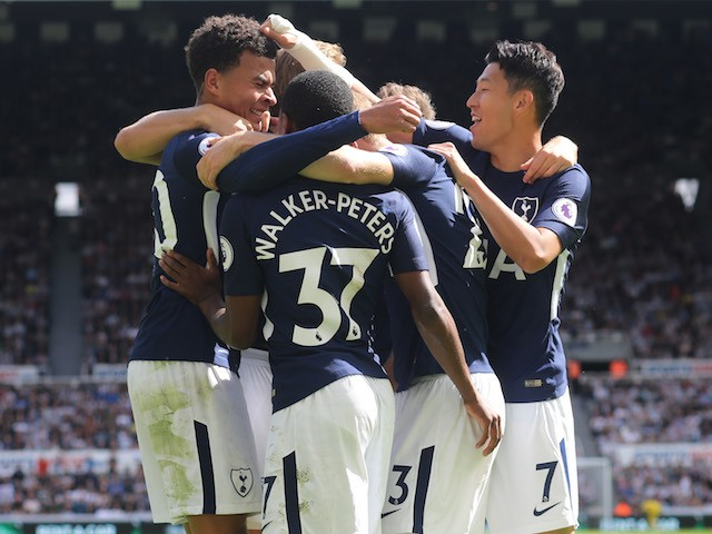 Dele Alli is congratulated by teammates after scoring during the Premier League game between Newcastle United and Tottenham Hotspur on August 13, 2017