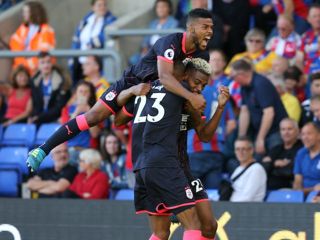 Elias Kachunga and Steve Mounie celebrate during the Premier League game between Crystal Palace and Huddersfield Town on August 12, 2017