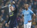 Wayne Rooney celebrates next to City captain Vincent Kompany during the Premier League game between Manchester City and Everton on August 21, 2017