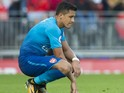Alexis Sanchez sits dejected during the Premier League game between Liverpool and Arsenal on August 27, 2017