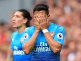 Alexis Sanchez hides his face in shame during the Premier League game between Liverpool and Arsenal on August 27, 2017