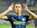 Inter Milan forward Ivan Perisic gestures to the fans