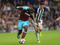 Michail Antonio cops a feel of Gareth Barry during the Premier League game between West Bromwich Albion and West Ham United on September 16, 2017