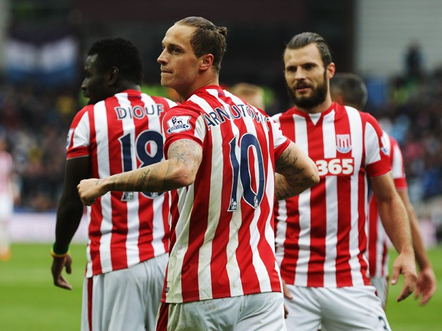 Marko Arnautovic of Stoke City celebrates scoring his team's first goal during the Barclays Premier League match between Aston Villa and Stoke City at Villa Park on October 3, 2015
